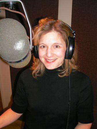 Voice artist Melinda Kordich in black